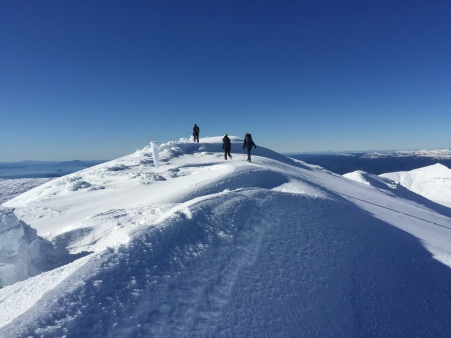 Walking along the ridge at the top in search of a better view