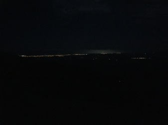 The lights of New Plymouth in the distance.