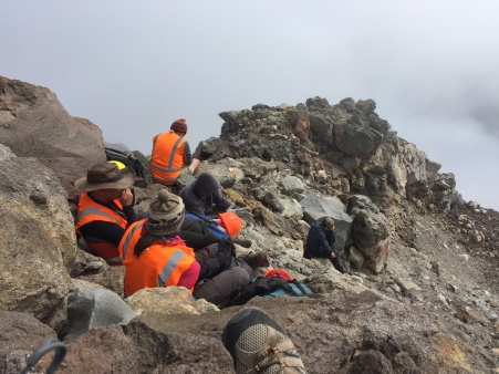 The whole team having a snack at the top while the wait for me to finally catch up.