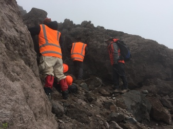 We found a good outcrop! Now everybody look for the perfect spot to take our samples!