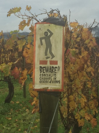 Awesomely gruesome caution sign at a north Auckland winery.