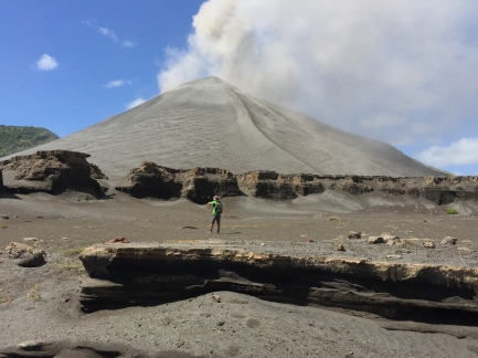 Yasur volcano in all its glory, as seen from a dried-up lake bed nearby