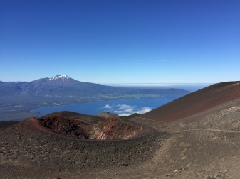 A red scoria crater with Calbuco and the lake behind.